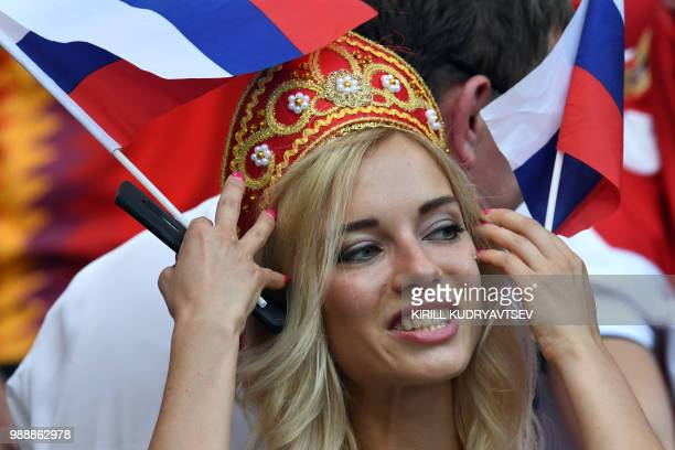 A Russia's fan gestures before the Russia 2018 World Cup round of 16 football match between Spain and Russia at the Luzhniki Stadium in Moscow on...