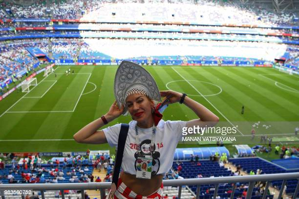 A Russia's fan poses before the Russia 2018 World Cup Group A football match between Uruguay and Russia at the Samara Arena in Samara on June 25 2018...