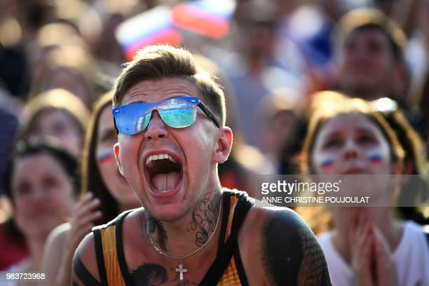 A Russia's fan reacts while watching in the Fans Zone of Ekaterinburg the Russia 2018 World Cup Group A football match between Uruguay and Russia on...