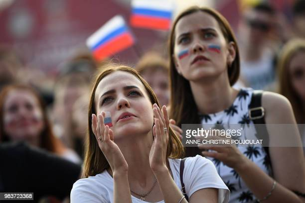 Russia's fan reacts while watching on a giant screen in the Fans Zone of Ekaterinburg, the Russia 2018 World Cup Group A football match between...