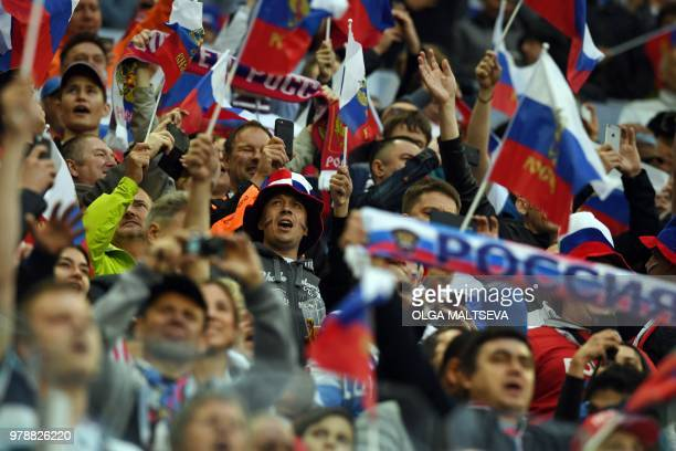 Russia's fans cheer during the Russia 2018 World Cup Group A football match between Russia and Egypt at the Saint Petersburg Stadium in Saint...