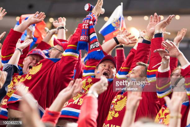 Russia's fans cheer on the standt during the Ice Hockey World Championship thirdplace match between Finland and Russia in the Lanxess Arena in...