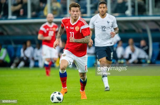 Russia's Fedor Smolov plays the ball during the International friendly football match at Saint Petersburg Stadium on March 27 2018 in SaintPetersburg...