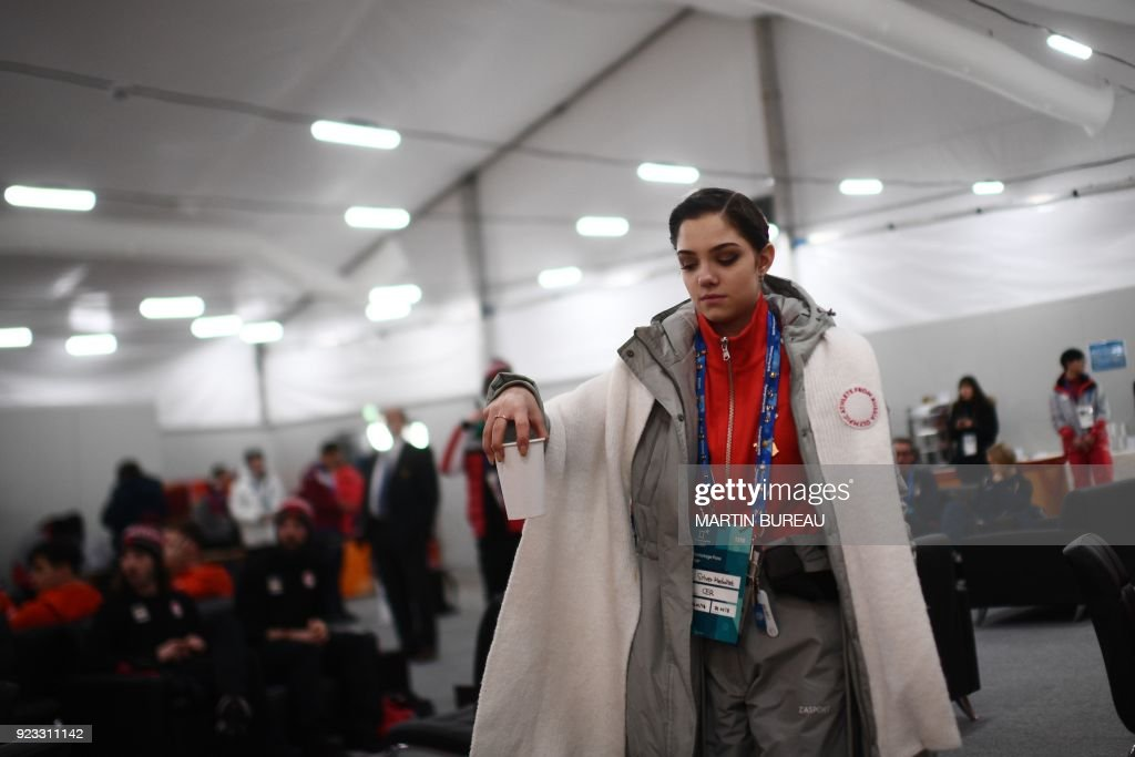 Russia's figure skating silver medallist Evgenia Medvedeva picks up a beverage backstage at the Athletes' Lounge during the medal ceremonies at the Pyeongchang Medals Plaza during the Pyeongchang 2018 Winter Olympic Games in Pyeongchang on February 23, 2018. / AFP PHOTO / Martin BUREAU