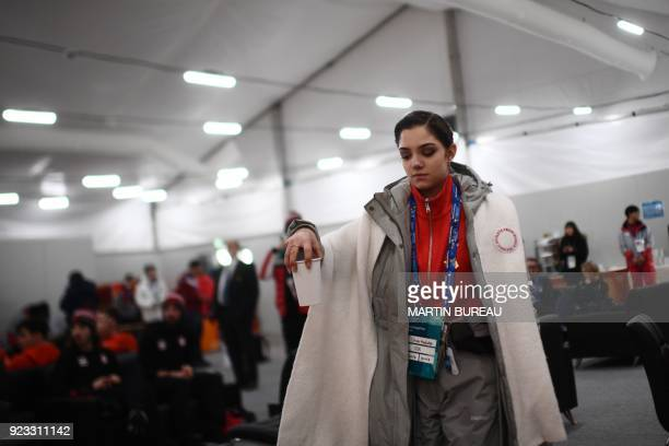 Russia's figure skating silver medallist Evgenia Medvedeva picks up a beverage backstage at the Athletes' Lounge during the medal ceremonies at the...