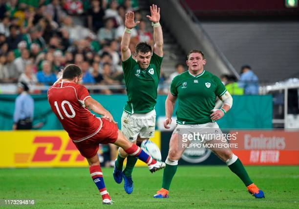 Russia's fly-half Ramil Gaisin kicks the ball as Ireland's scrum-half Luke McGrath jumps to block it during the Japan 2019 Rugby World Cup Pool A...