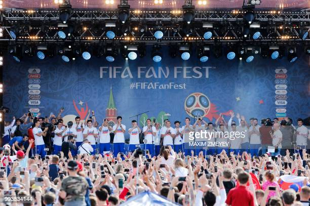 TOPSHOT Russia's football team players are greeted by fans during a visit at the Moscow's fan zone on July 8 2018