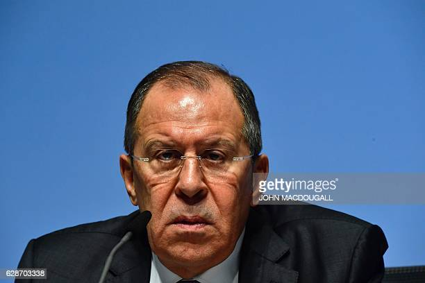 TOPSHOT Russia's Foreign Minister Sergei Lavrov addresses a press conference during the foreign ministers' meeting of the Organisation for Security...