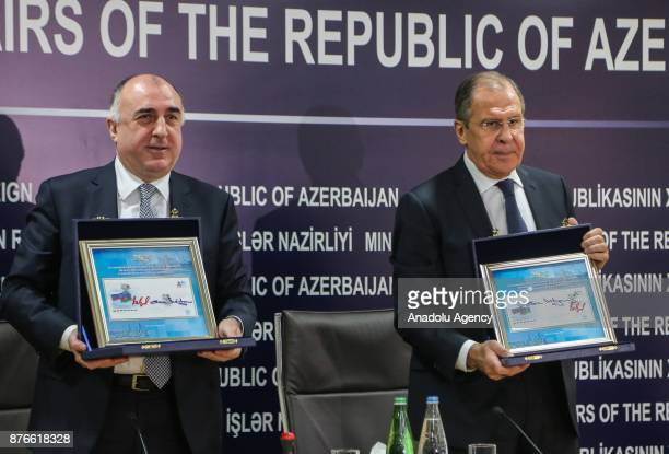 Russia's Foreign Minister Sergei Lavrov and Azerbaijan's Foreign Minister Elmar Mammadyarov hold sealed envelopes marking the 25th anniversary of...