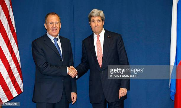 Russia's Foreign Minister Sergei Lavrov and US Secretary of State John Kerry meet to discuss the Ukraine crisis on the sidelines of an International...