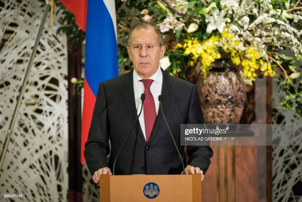 Russia's Foreign Minister Sergei Lavrov attends a press conference after a meeting with his Japanese counterpart Taro Kono at the Iikura House in Tokyo on March 21, 2018. Russia's foreign minister Lavrov threatened on March 21 to retaliate against Britain for 'anti-Russian measures', with the two countries at loggerheads over the poisoning of a spy in southern England. / AFP PHOTO / POOL / Nicolas Datiche