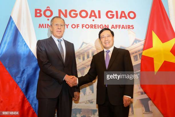 Russia's Foreign Minister Sergei Lavrov shakes hands with his Vietnamese counterpart Pham Binh Minh as they meet at the Government Guest House in...