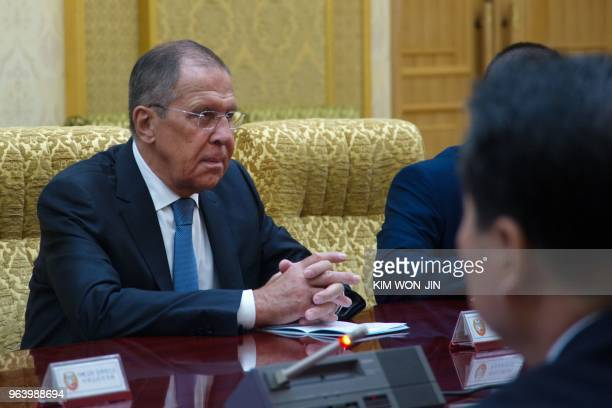 Russia's Foreign Minister Sergei Lavrov talks with North Korea's Foreign Minister Ri Yong Ho at the Mansudae Assembly Hall in Pyongyang on May 31...