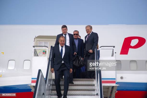 Russia's Foreign Minister Sergei Lavrov walks down the airplane as he arrives in Pyongyang on May 31, 2018. - Russian Foreign Minister Sergei Lavrov...