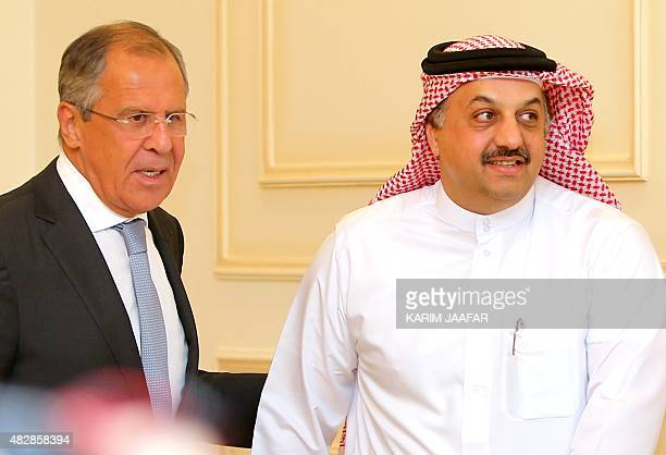 Russia's Foreign Minister Sergey Lavrov and Qatari Foreign Minister Khalid bin Mohammad AlAttiyah arrive for a press conference on August 3 2015 in...