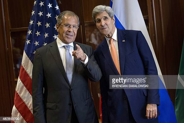 Russia's Foreign Minister Sergey Lavrov and US Secretary of State John Kerry talk before a trilateral meeting on August 3 2015 in Doha Kerry is...
