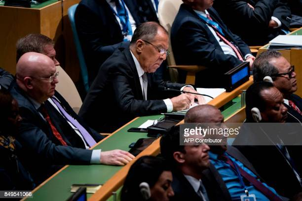 Russia's Foreign Minister Sergey Lavrov looks at papers while US President Donald Trump addresses the 72nd session of the United Nations General...