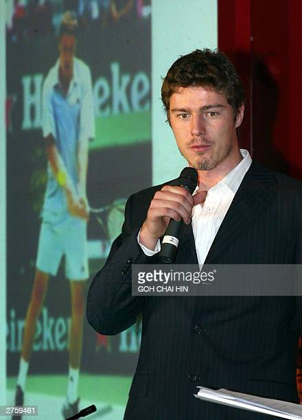 Russia's former World number one Marat Safin who is recovering from an injury talks to the press during a ceremony in Beijing 25 November 2003 to...