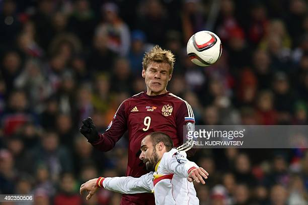 Russia's forward Aleksandr Kokorin vies for the ball with Montenegro's defender Sasa Balic during the UEFA Euro 2016 group G qualifying football...