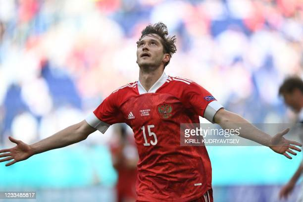 Russia's forward Aleksey Miranchuk celebrates scoring the opening goal during the UEFA EURO 2020 Group B football match between Finland and Russia at...