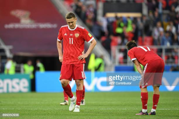 Russia's forward Alexander Bukharov and Russia's midfielder Alexander Golovin react during the 2017 Confederations Cup group A football match between...