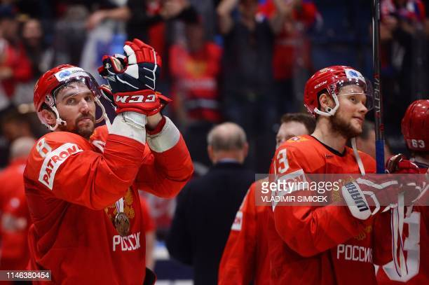 Russia's forward Alexander Ovechkin and Russia's forward Sergei Andronov celebrate winning the IIHF Men's Ice Hockey World Championships bronze medal...