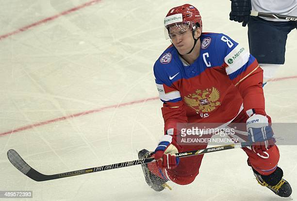 Russia's forward Alexander Ovechkin feels the impact during a preliminary round group B game Russia vs Finland of the IIHF International Ice Hockey...