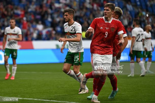 Russia's forward Alexander Sobolev scores the opening goal from the penalty spot during the friendly football match Russia v Bulgaria in Moscow on...