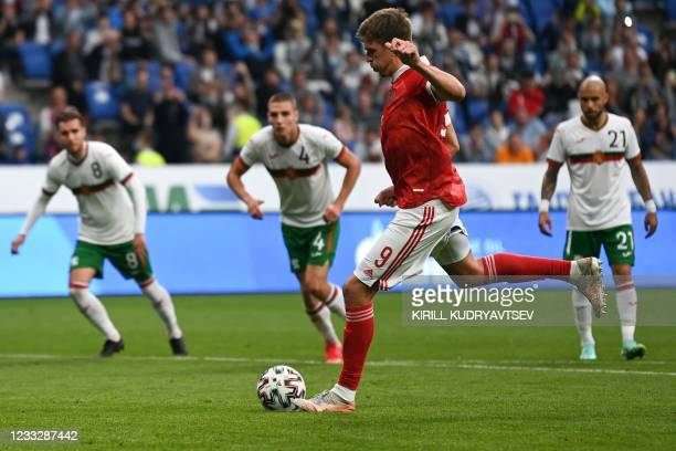 Russia's forward Alexander Sobolev shoots to score the opening goal from the penalty spot during the friendly football match Russia v Bulgaria in...
