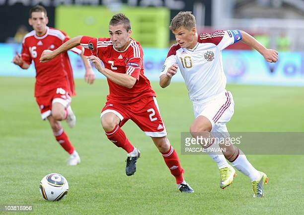 Russia's forward Andrey Arshavin vies with Andorran Jordi Rubio during their Euro 2012 qualifying football match Andorra vs Russia on September 3...