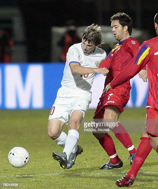 Russia's forward Andrey Arshavin vies with Andorra's midfielder Marco Vieira during their Euro 2008 Group E qualification football match 21 November...