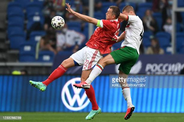Russia's forward Artem Dzyuba and Bulgaria's defender Valentin Antov vie for the ball during the friendly football match Russia v Bulgaria in Moscow...