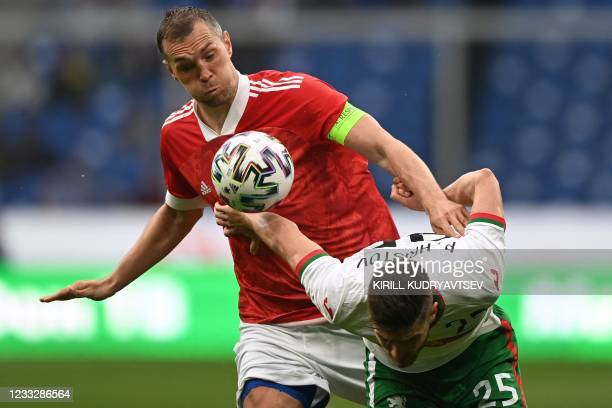 Russia's forward Artem Dzyuba and Bulgaria's Petko Hristov vie for the ball during the friendly football match Russia v Bulgaria in Moscow on June 5...