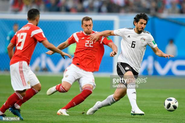 Russia's forward Artem Dzyuba and Egypt's defender Ahmed Hegazi vie during the Russia 2018 World Cup Group A football match between Russia and Egypt...