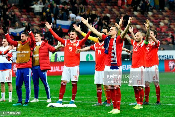 Russia's forward Artem Dzyuba and teammates celebrate after the Euro 2020 football qualification match between Russia and Scotland at the Luzhniki...