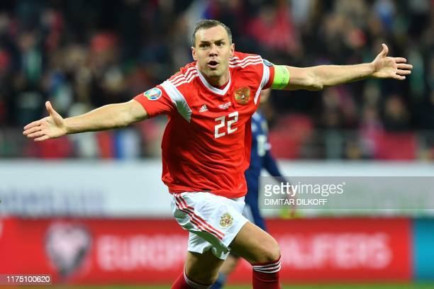 Russia's forward Artem Dzyuba celebrates after scoring a goal during the Euro 2020 football qualification match between Russia and Scotland at the...