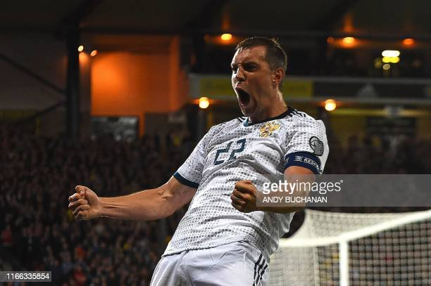 Russia's forward Artem Dzyuba celebrates after scoring the equalising goal during the UEFA Euro 2020 Qualifying 1st round Group I football match...