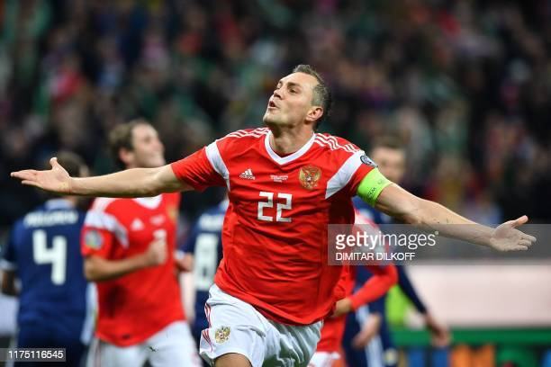 Russia's forward Artem Dzyuba celebrates after scoring the team's third goal during the Euro 2020 football qualification match between Russia and...