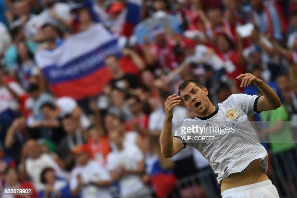 Russia's forward Artem Dzyuba celebrates after scoring their first goal on a penalty kick during the Russia 2018 World Cup round of 16 football match...