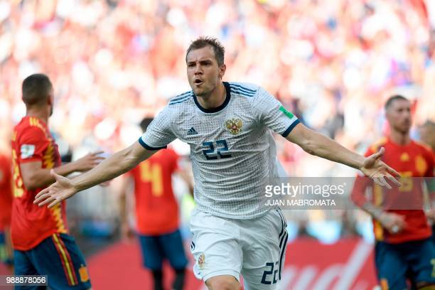TOPSHOT Russia's forward Artem Dzyuba celebrates after shooting a penalty kick and score a goal during the Russia 2018 World Cup round of 16 football...