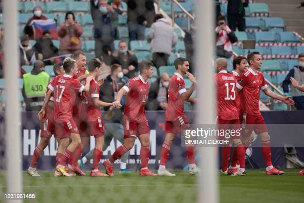 Russia's forward Artem Dzyuba celebrates with teammates after scoring the team's second goal during the FIFA World Cup Qatar 2022 qualification...