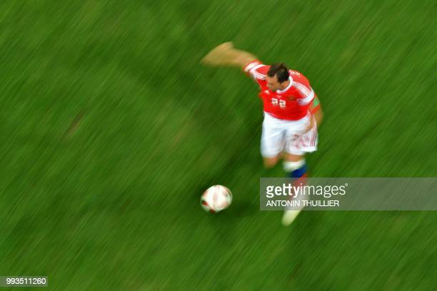 Russia's forward Artem Dzyuba controls the ball during the Russia 2018 World Cup quarterfinal football match between Russia and Croatia at the Fisht...