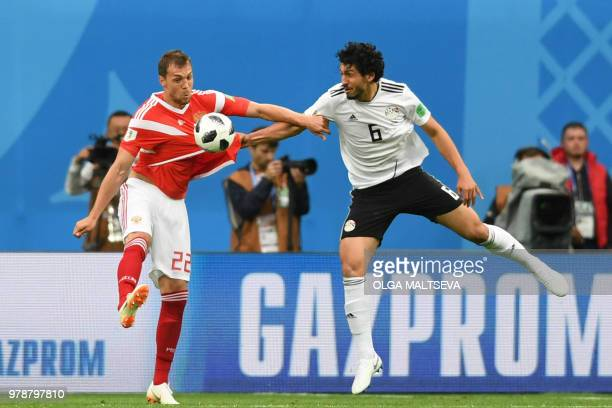 Russia's forward Artem Dzyuba fights for the ball with Egypt's defender Ahmed Hegazi during the Russia 2018 World Cup Group A football match between...