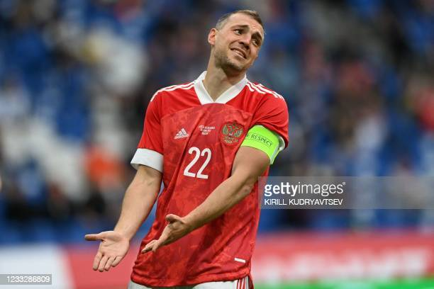 Russia's forward Artem Dzyuba reacts during the friendly football match Russia v Bulgaria in Moscow on June 5 in preparation for the UEFA European...