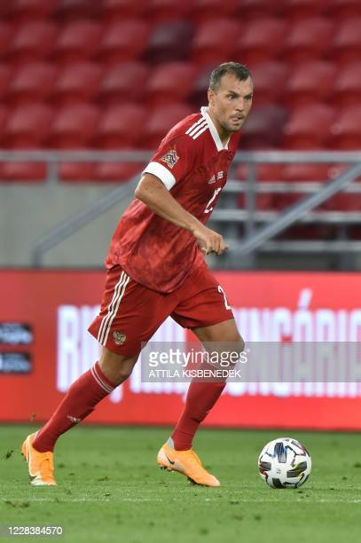 Russia's forward Artem Dzyuba runs with the ball during the UEFA Nations League football match between Hungary and Russia on September 6, 2020 at the...