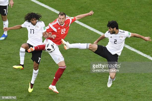 Russia's forward Artem Dzyuba vies for the ball with Egypt's midfielder Mohamed Elneny and Egypt's defender Ali Gabr during the Russia 2018 World Cup...