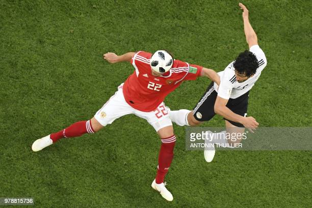 Russia's forward Artem Dzyuba vies for the header with Egypt's defender Ahmed Hegazi during the Russia 2018 World Cup Group A football match between...