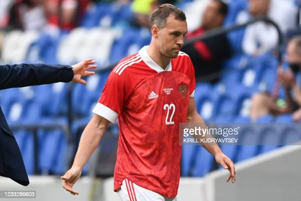 Russia's forward Artem Dzyuba walks off the pitch after being substituted during the friendly football match Russia v Bulgaria in Moscow on June 5 in...