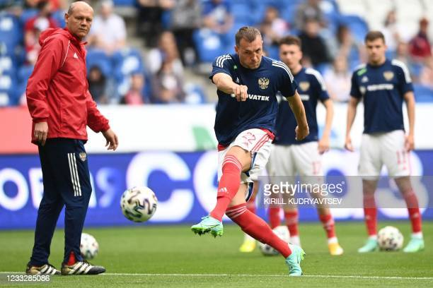 Russia's forward Artem Dzyuba warms up prior to the friendly football match Russia v Bulgaria in Moscow on June 5 in preparation for the UEFA...