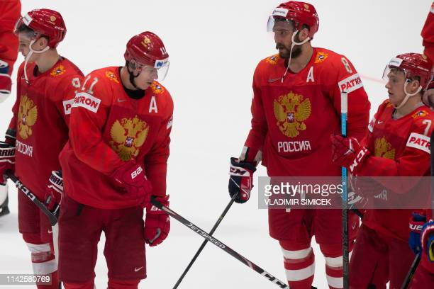 Russias forward Evgeni Malkin and Russia's forward Alexander Ovechkin celebrate after winning their IIHF Men's Ice Hockey World Championships Group B...